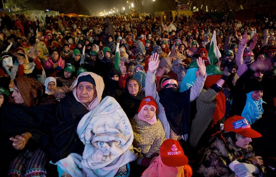 Supporters of Pakistani Sunni Muslim cleric Tahir-ul-Qadri, listen to their leader at a rally in Islamabad, Pakistan Tuesday, Jan. 15, 2013. Qadri said that the current government had lost their mandate and therefore he gave them a deadline till morning to resign from their assemblies on their own. (AP Photo/B.K. Bangash)