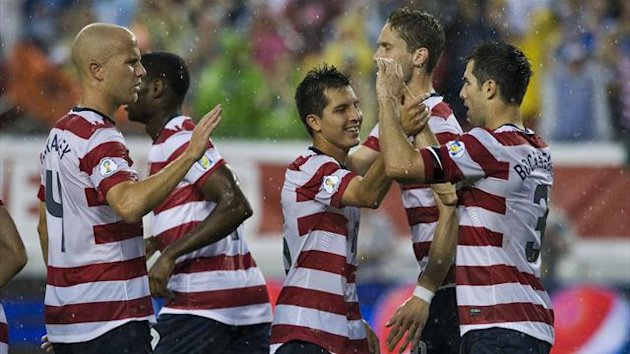Michael Bradley (L) and Jose Torres (C) of the U.S. congratulate their teammate Carlos Bocanegra (3) after his goal against Antigua & Barbuda during the first half of their 2014 World Cup Qualifier soccer match in Tampa, Florida
