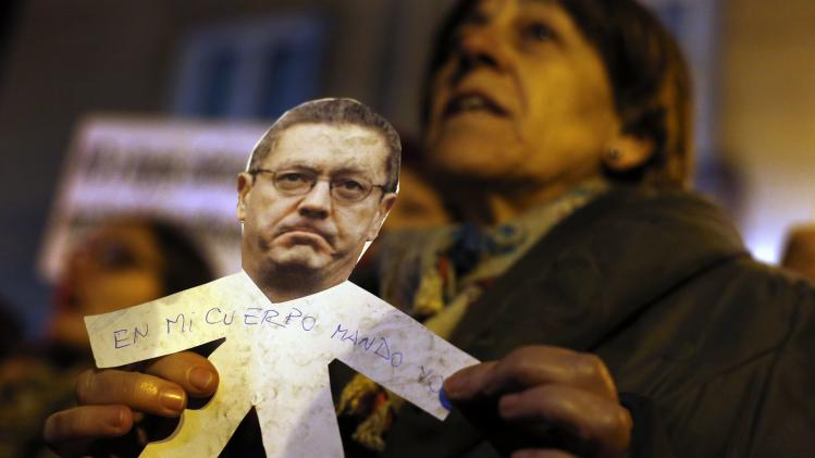 A demonstrator holds a paper cut-out during a pro-choice protest against the proposed new abortion law in Madrid