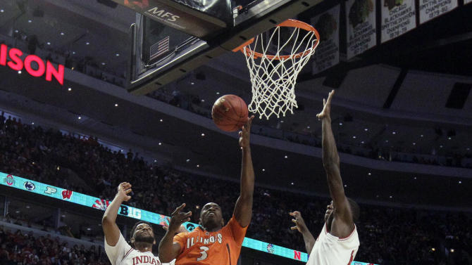 Illinois' Brandon Paul (3) shoots past Indiana's Christian Watford (2) and Yogi Ferrell during the first half of an NCAA college basketball game at the Big Ten tournament Friday, March 15, 2013, in Chicago. (AP Photo/Nam Y. Huh)