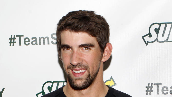 Olympic swimming champion Michael Phelps joins his sister Whitney as she announces that she will run the ING New York City Marathon with Team SUBWAY at the Chelsea Piers Sport Center, Monday, Oct. 15, 2012 in New York. (Photo by Jason DeCrow/Invision for SUBWAY/AP Images)