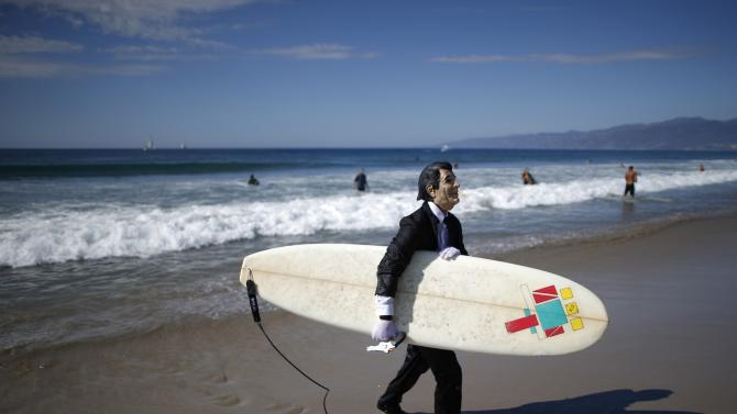 JohnPaul Trotter, 31, walks out of the ocean dressed as President Ronald Reagan after competing in the 7th annual ZJ Boarding House Haunted Heats Halloween surf contest in Santa Monica