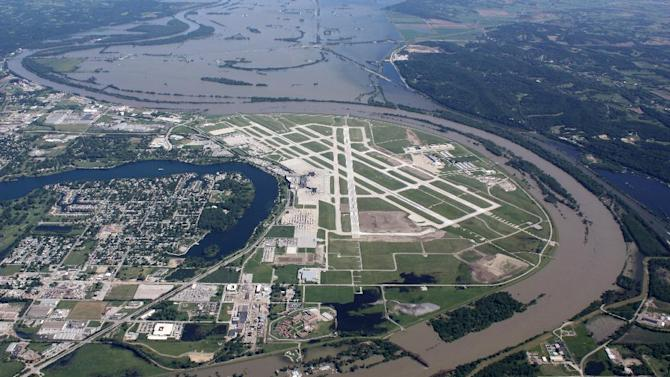 This aerial handout photo provided by the Omaha Airport Authority, taken June 15, 2011, shows flooding around the airport in Omaha, Neb. Extreme weather is a growing threat to the nation's lifelines _ its roads, bridges, railways, airports and transit systems _ leaving states and cities trying to come to terms with a new normal.  (AP Photo/Omaha Airport Authority)