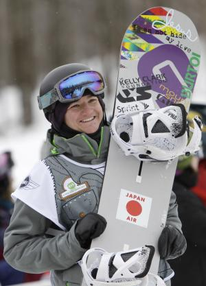 Kelly Clark of the United States reacts to winning the women's half-pipe at the U.S. Open Snowboarding Championships in Stratton, Vt. on Saturday, March 12, 2011. (AP Photo/Mike Groll)
