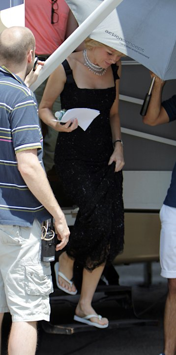 Naomi Watts as Diana leaves her trailer in a black sequin gown and multi-tiered diamond necklace