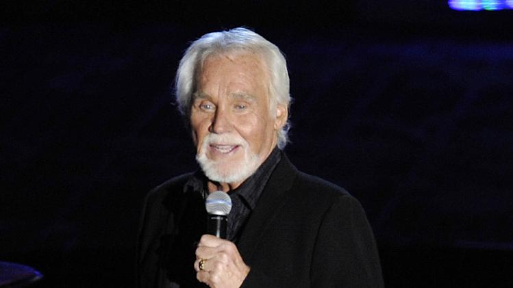 FILE - This June 14, 2012 file photo shows singer Kenny Rogers performing at the 2012 Songwriters Hall of Fame induction and awards gala at the Marriott Marquis Hotel in New York. The northeast Georgia home owned by country singer Kenny Rogers that was scheduled to be put up for auction has been sold. Grand Estates Auction Co. in Charlotte, N.C., says Rogers sold the house and its 150 acres Wednesday, June 27, for $2.25 million. The property is located near Nicholson, Ga., and included a 5,681-square-foot-house, a 2,675-square foot pool, an 8-acre lake, horse riding trails, go-cart track and other amenities. (Photo by Evan Agostini/Invision, file)