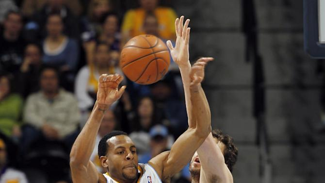 Denver Nuggets forward Andre Iguodala (9) passes the ball as Los Angeles Lakers forward Pau Gasol, of Spain, defends in the first quarter of an NBA basketball game in Denver, Wednesday, Dec. 26, 2012. (AP Photo/David Zalubowski)