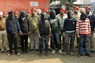 Indian police escort the six men accused of a gang rape in Punjab to a courthouse in Gurdaspur on Januray 13, 2013. Indian police have arrested six men over the rape of a passenger on a coach in the northern state of Punjab, weeks after a similar attack in New Delhi sparked nationwide protests