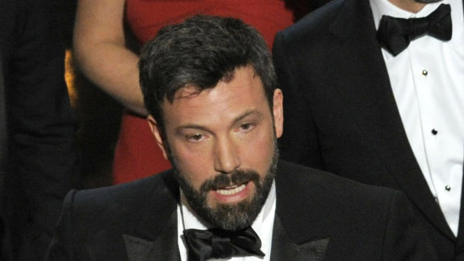 """Director/producer Ben Affleck accepts the award for best picture for """"Argo"""" during the Oscars at the Dolby Theatre on Sunday Feb. 24, 2013, in Los Angeles. (Photo by Chris Pizzello/Invision/AP)"""