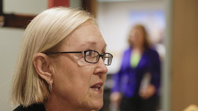 In this photo taken April 29, 2013, Susan Gumm of Omaha, Neb., talks to the Associated Press about her views on immigration reform, after attending a town meeting with Sen. Deb Fischer, R-Neb., rear right, in Nebraska City, Neb. Gumm said Republicans who advocate writing new law over enforcing statutes on the books are giving up on a key tenet of the GOP, and will destroy the Republican Party. (AP Photo/Nati Harnik)