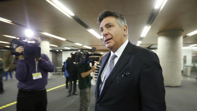 Ontario Finance Minister Charles Sousa arrives to speak to journalists before the start of a meeting with federal, provincial and territorial finance ministers in Ottawa