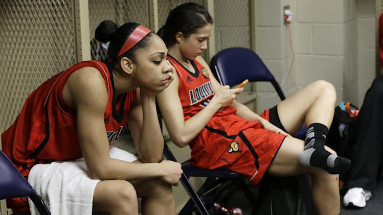 Louisville guard Bria Smith, left, and Louisville guard Jude Schimmel (22) sit in the locker room after defeating Louisville 93-60 in the national championship game of the women's Final Four of the NCAA college basketball tournament, Tuesday, April 9, 2013, in New Orleans.  (AP Photo/Dave Martin)