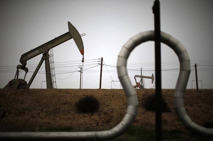 Oil prices extend losses on U.S. oil inventory, manufacturing data