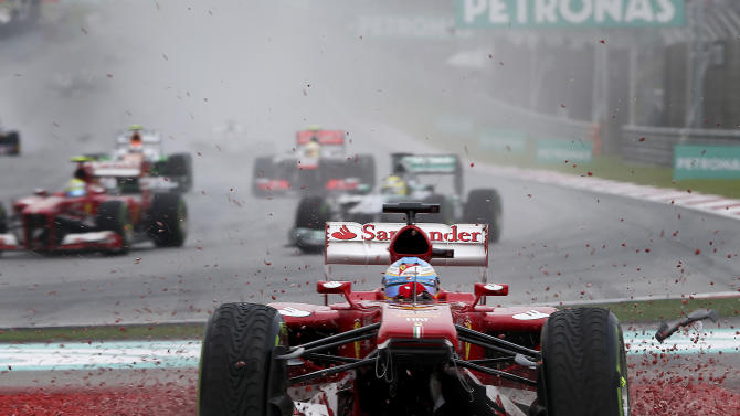 Ferrari driver Fernando Alonso of Spain goes off the track during the Malaysian Formula One Grand Prix at Sepang, Malaysia, Sunday, March 24, 2013. (AP Photo)