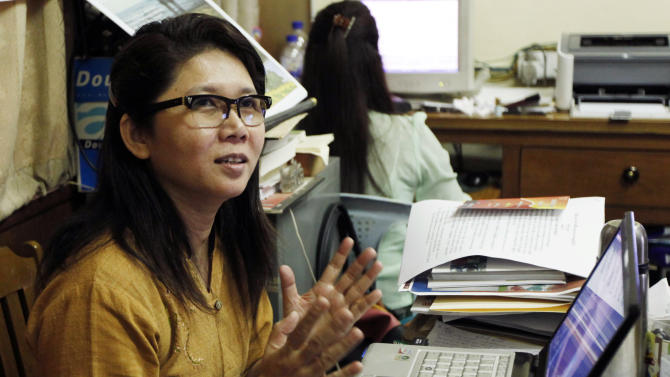 In this photo taken on Thursday, Jan. 31, 2013, author Ma Thida gestures while talking during an interview at her office in Yangon, Myanmar. Nearly two years into reformist president Thein Sein's term, the rush of hope and idealism that greeted many new freedoms - most strikingly freedom of speech - is turning into a measured assessment of the country's progress. Long accustomed to writing around censorship, Myanmar's writers are relearning the habits of free thought and testing the boundaries of speech.  (AP Photo/Khin Maung Win)