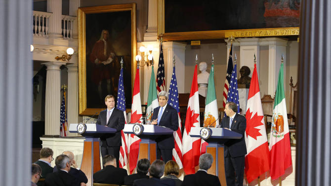 U.S. Secretary of State John Kerry, center, speaks at a news conference with Canadian Foreign Minister John Baird, left, and Mexican Foreign Secretary Jose Antonio Meade at Faneuil Hall in Boston Saturday, Jan. 31, 2015. (AP Photo/Winslow Townson)