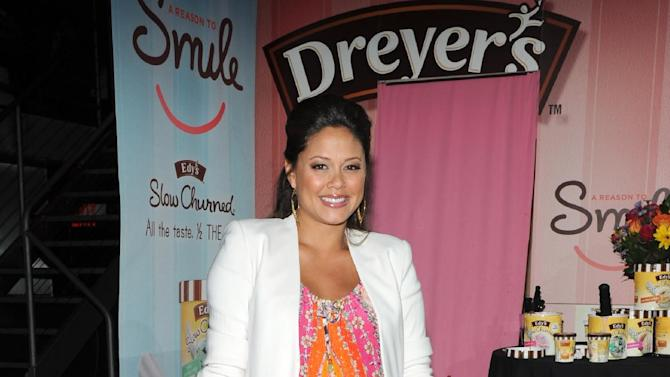 COMMERCIAL IMAGE -   Mom-to-be Vanessa Lachey indulged in a sweet treat of Edy's Slow Churned Light Ice Cream, while helping the brand give away scoops to raise money for Operation Smile on Thursday, Aug. 2, 2012 in New York.  (Photo by Diane Bondareff/Invision for Edy's Slow Churned/AP Images)