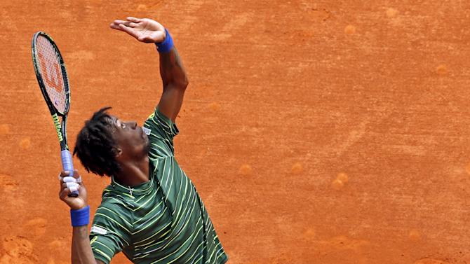 Monfils of France serves during his men's singles semi-final tennis match against Berdych of the Czech Republic at the Monte Carlo Masters in Monaco