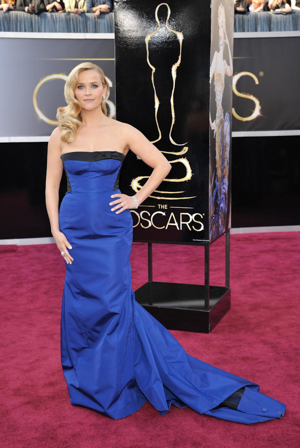 Reese Witherspoon arrives at the 85th Academy Awards at the Dolby Theatre on Sunday Feb. 24, 2013, in Los Angeles. (Photo by John Shearer/Invision/AP)