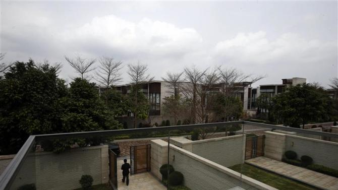 File photo of a property agent walking out of a house for sale by a mainland Chinese inside a luxury estate in Hong Kong