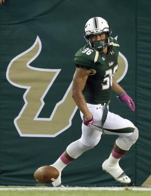 USF beats Cincinnati 26-20 for Taggart's 1st win