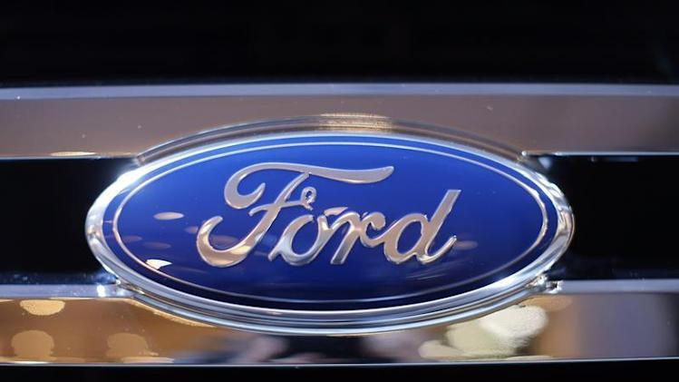 A Ford logo is seen on a car during a press preview at the 2013 New York International Auto Show in New York