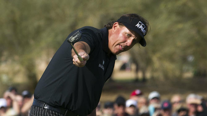 Phil Mickelson watches his birdie putt roll towards the cup on the ninth green during first round of the Phoenix Open golf tournament, Thursday, Jan. 31, 2013,  in Scottsdale, Ariz. Mickelson's putt lipped-out, and he had to settle for par on the hole. (AP Photo/The Arizona Republic, Rob Schumacher)  MARICOPA COUNTY OUT; MAGS OUT; NO SALES