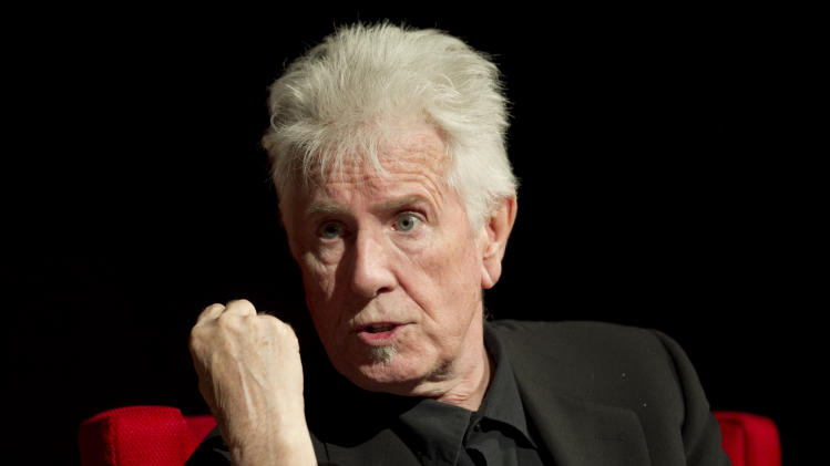 FILE - In this April 8, 2014 file photo, Rock and Roll Hall of Fame singer-songwriter Graham Nash speaks during the Civil Rights Summit at the Lyndon B. Johnson Presidential Library, in Austin, Texas. The 72-year-old member of Crosby, Stills and Nash spoke exclusively to The Associated Press on Monday, July 7, 2014, after the Paley Center for Media hosted a discussion with the trio regarding their newly released remastered box set commemorating their 1974 tour with Neil Young. (AP Photo/Statesman.com, Jay Janner, Pool, File)