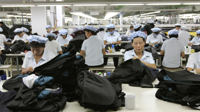 FILE - In this Sept. 21, 2012 file photo, North Korean workers assemble Western-style suits at the South Korean-run ShinWon Corp. garment factory inside the Kaesong industrial complex in Kaesong, North Korea. South Korea's government said Thursday, July 4, 2013 that it has has reached out to North Korea to discuss restarting the jointly run factory park after weeks of testy silence between the two sides. The industrial complex in the North Korean city of Kaesong, just north of the Demilitarized Zone dividing the two Koreas, has been shut since a political showdown in April. (AP Photo/Jean H. Lee, File)