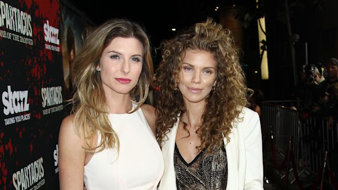 "IMAGE DISTRIBUTED FOR STARZ - Viva Bianca, left, and AnnaLyne McCord arrive at the premiere of ""Spartacus: War of the Damned"" on Tuesday, Jan. 22, 2013 in Los Angeles. ""Spartacus: War of the Damned"" premieres Friday, Jan. 25 at 9PM on STARZ. (Photo by Matt Sayles/Invision for STARZ/AP Images)"