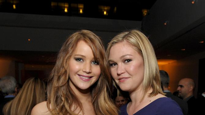 Jennifer Lawrence, left, and Julia Stiles attend The Hollywood Reporter Nominees' Night at Spago on Monday, Feb. 4, 2013, in Beverly Hills, Calif. (Photo by John Shearer/Invision for The Hollywood Reporter/AP Images)
