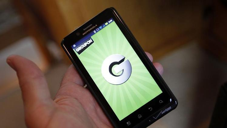 The Groupon smartphone app is displayed on a Motorola Droid Bionic cell phone in Denver