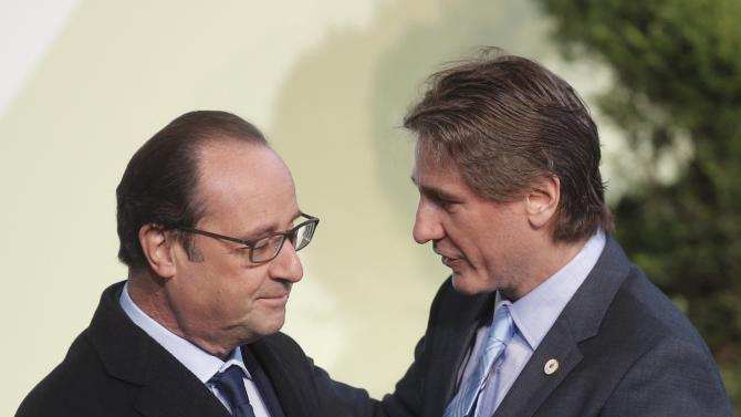 French President Hollande welcomes Argentina's Vice President Boudou as he arrives for the opening day of the World Climate Change Conference 2015 (COP21) at Le Bourget, near Paris