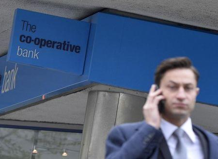 A pedestrian passes a branch of the Co-operative bank in central London