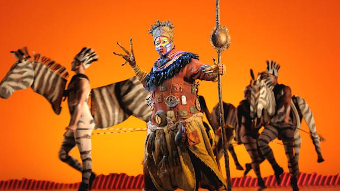 """FILE - In this photo provided by the Las Vegas News Bureau, a scene is shown during a performance of Disney's """"The Lion King,"""" in Las Vegas. Families of autistic children have a new venue to engage their sons or daughters, Broadway. The Theatre Development Fund, a nonprofit focused on providing access to live theater, announced it will present the first autism-friendly performance on Broadway when it offers a special showing of """"The Lion King."""" (AP/Photo/Las Vegas News Bureau, Darrin Bush)"""