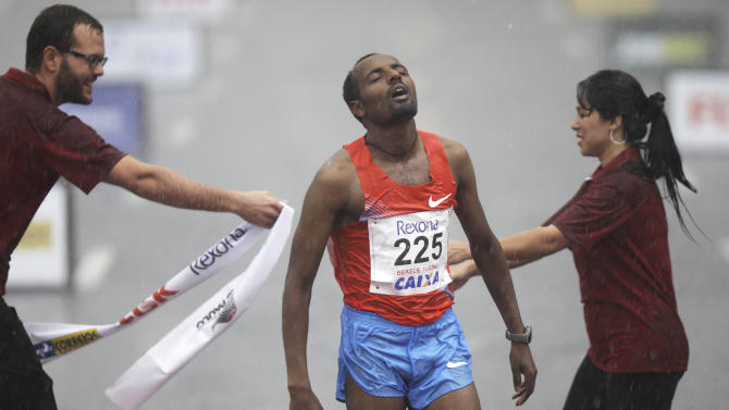 Ethiopia's Bekele Tariku reacts as he crosses the finish line to win the Sao Silvestre men's race in Sao Paulo, Brazil, Saturday, Dec. 31, 2011. The 15-kms race is held annually on New Year's Eve. (AP Photo/Nelson Antoine)