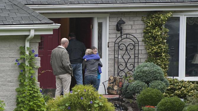 Visitors arrive at the home of Jeffrey Giuliano in New Fairfield, Conn., Friday, Sept. 28, 2012. Giuliano fatally shot a masked teenager in self-defense during what appeared to be an attempted burglary early Thursday morning, then discovered that he had killed his son, Tyler, state police said. (AP Photo/Jessica Hill)