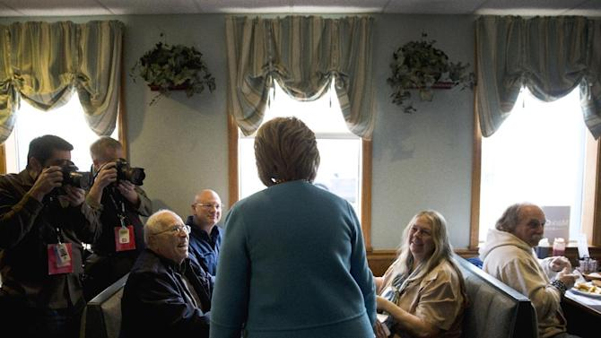 Democratic presidential candidate Hillary Clinton meets costumers before eating breakfast, Monday, Feb. 8, 2016, at Chez Vachon restaurant in , N.H. (AP Photo/Matt Rourke)