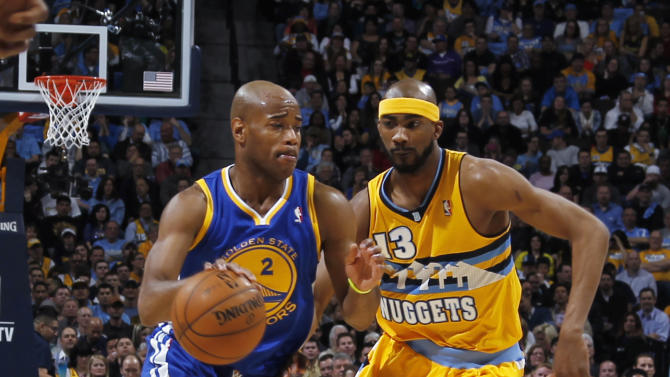 Golden State Warriors guard Jarrett Jack, left, works the ball inside past Denver Nuggets forward Corey Brewer in the first quarter of Game 2 of the teams' NBA first-round playoff series in Denver on Tuesday, April 23, 2013. (AP Photo/David Zalubowski)
