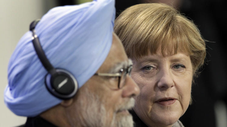German Chancellor Angela Merkel, right, and the Prime Minister of India, Manmohan Singh, left, address the media during a press conference as part of a meeting at the chancellery in Berlin, Germany, Thursday, April 11, 2013. (AP Photo/Michael Sohn)