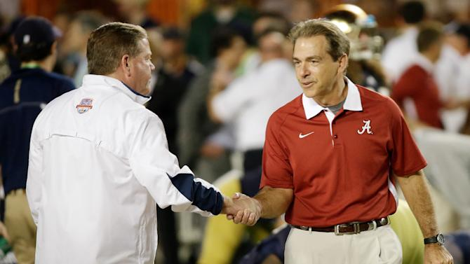 Notre Dame head coach Brian Kelly, left, shakes hands with Alabama head coach Nick Saban before the BCS National Championship college football game Monday, Jan. 7, 2013, in Miami. (AP Photo/David J. Phillip)