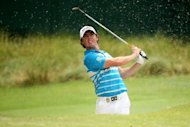 Rory McIlroy of Northern Ireland hits a bunker shot during a practice round of the 94th PGA Championship at the Ocean Course on August 8. All 100 of the top ranked players in the world will tee it up at Kiawah Island Golf Resort for the final major championship of the season