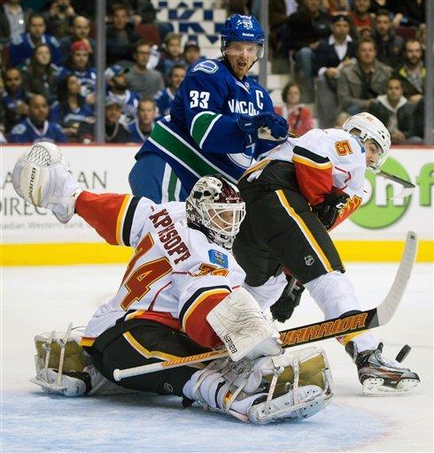 Schneider, Kassian lift Canucks past Flames in SO