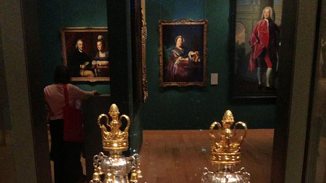 In this Nov. 13, 2012 photo provided by David Bazarsky, a set of 18th century Torah finial bells are seen on display at the Museum of Fine Arts, in Boston. A disagreement over the ownership of the bells has prompted lawsuits between leaders of the nation's first Jewish congregation and the nation's oldest synagogue. The dispute started after leaders of the Touro Synagogue in Newport, R.I., agreed to sell the bells for $7.4 million to Boston's Museum of Fine Arts so they can set up an endowment to care for the synagogue. (AP Photo/David Bazarsky)