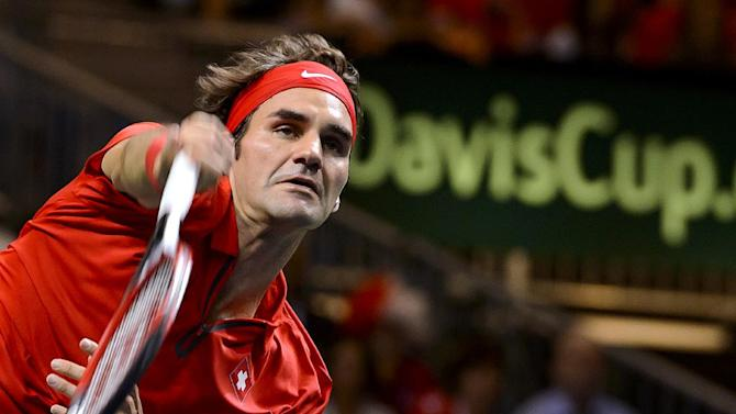 Switzerland's Roger Federer serves during the fourth tennis match of the Davis Cup semi-final between Switzerland and Italy on September 14, 2014 in Geneva