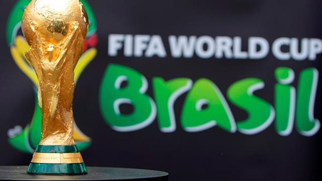 The 2014 FIFA World Cup Brazil trophy is displayed during its unveiling ceremony at a Soccerex event at Copacabana beach in Rio de Janeiro