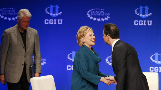 Former Secretary of State Hillary Rodham Clinton, center, greets talk show host Jimmy Kimmel as former President Bill Clinton, left, stands near during a student conference for the Clinton Global Initiative University, Saturday, March 22, 2014, at Arizona State University in Tempe, Ariz. More than 1,000 college students are gathered at Arizona State University this weekend as part of the Clinton Global Initiative University's efforts to advance solutions to pressing world challenges. (AP Photo/Matt York)