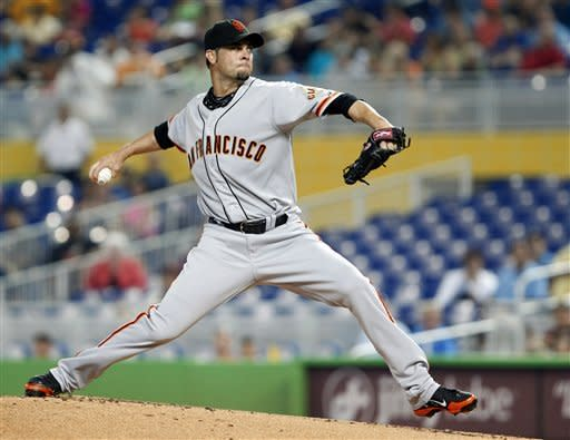 SF gets season-high 15 hits to beat Marlins 14-7