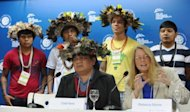 Rebecca Moore (R-front), Engineering Manager of Google Earth Engine and Earth Outreach, speaks alongside Brazilian Surui tribe Chief Almir (L-front) and members, during press conference in Rio de Janeiro, Brazil. Moore announced the creation of a Google culture map for the Surui tribe in Amazonia