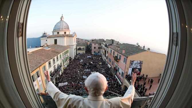 In this photo provided by the Vatican newspaper L'Osservatore Romano, Friday, March 1, 2013, then Pope Benedict XVI, delivers his last blessing from the window of the pontiff's summer residence of Castel Gandolfo, near Rome, after arriving from the Vatican, the last day of his pontificate, Thursday, Feb. 28, 2013. Benedict XVI left the Catholic Church in unprecedented limbo Thursday as he became the first pope in 600 years to resign, capping a tearful day of farewells that included an extraordinary pledge of obedience to his successor. (AP Photo/L'Osservatore Romano, ho)